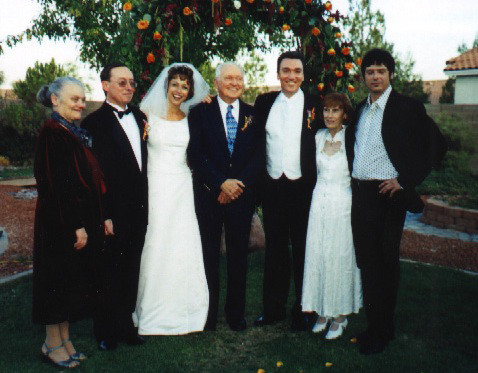 Paige Davis and Patrick Page pose with Patrick's family on their wedding day.